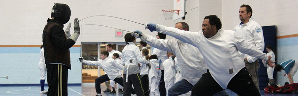 A student lunges during adult classes at Tidewater Fencing Club.
