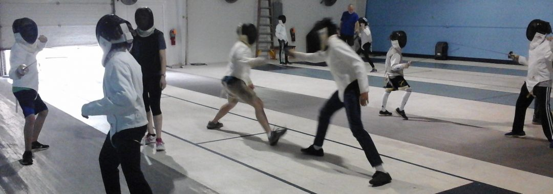 Fencers practicing skills in an Intermediate Class.
